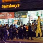 The Stilt Walker outside Sainsbury's