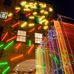 Neon Sculpture and Mise-en-abyme sculpture (foreground) by De Allegri and Fogale behind Oxo Tower